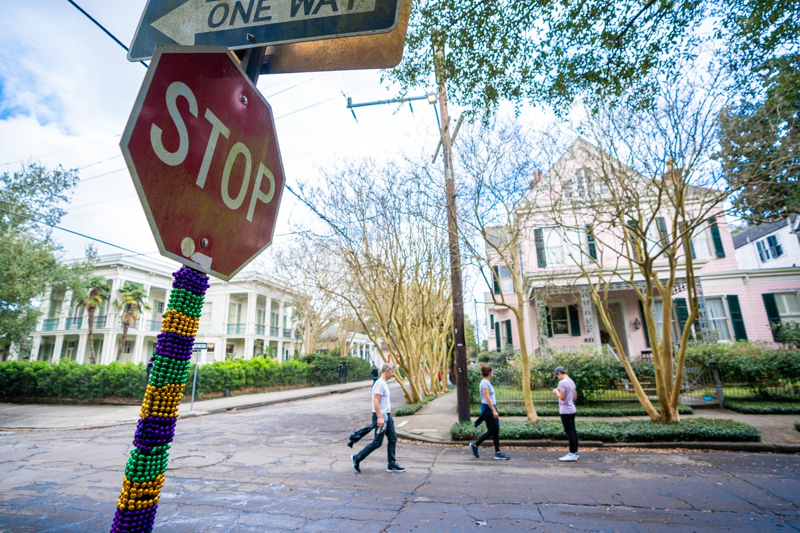 Mardi Gras beads on a stop sign in a residential part of the Garden District