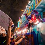 Krewe of Nyx parader blowing a kiss during Mardi Gras in New Orleans