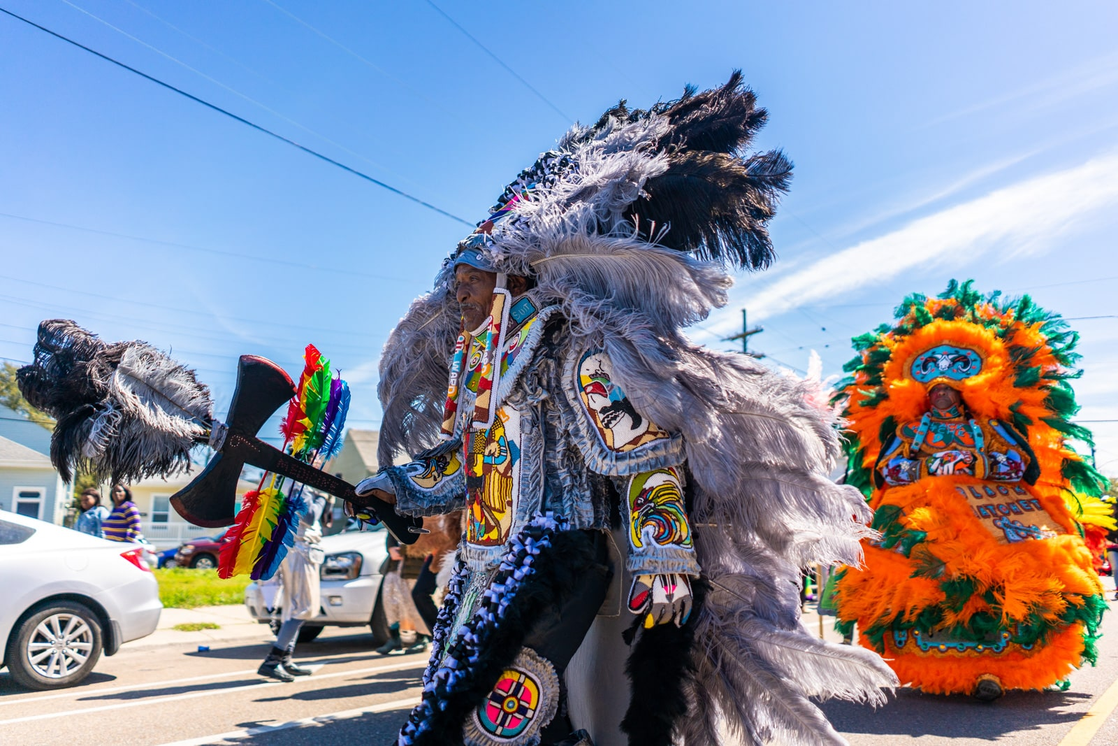 Mardi Gras Indian walking through the streets of New Orleans