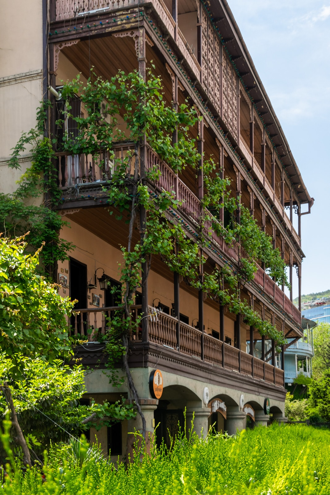 Old building with plants on balconies in Tbilisi, Georgia