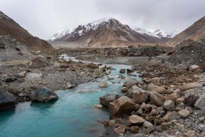 Blue glacial river flowing through the Chapursan Valley in Gilgit Baltistan, Pakistan