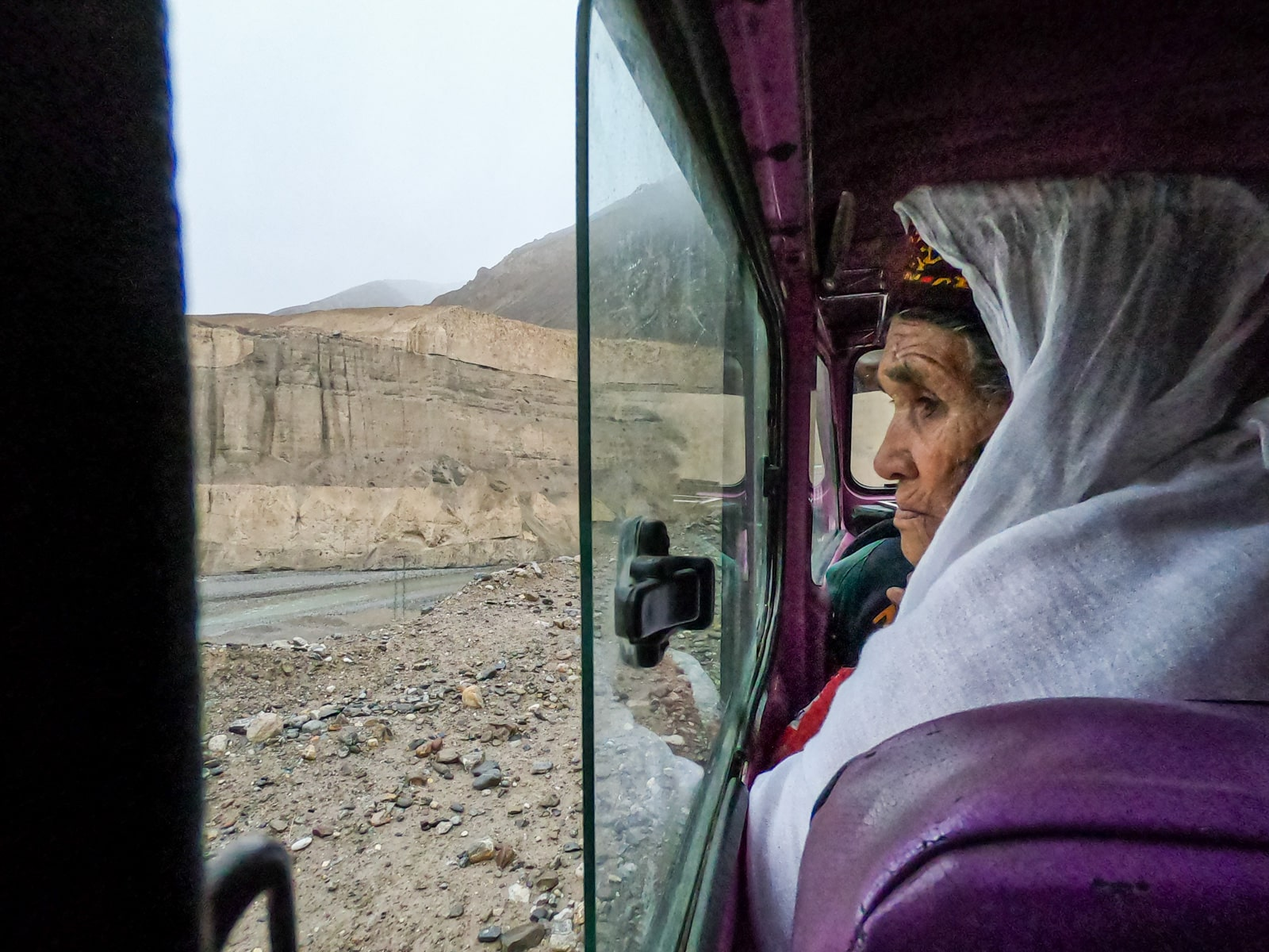 Old woman looking out the window in the jeep to Chapursan Valley