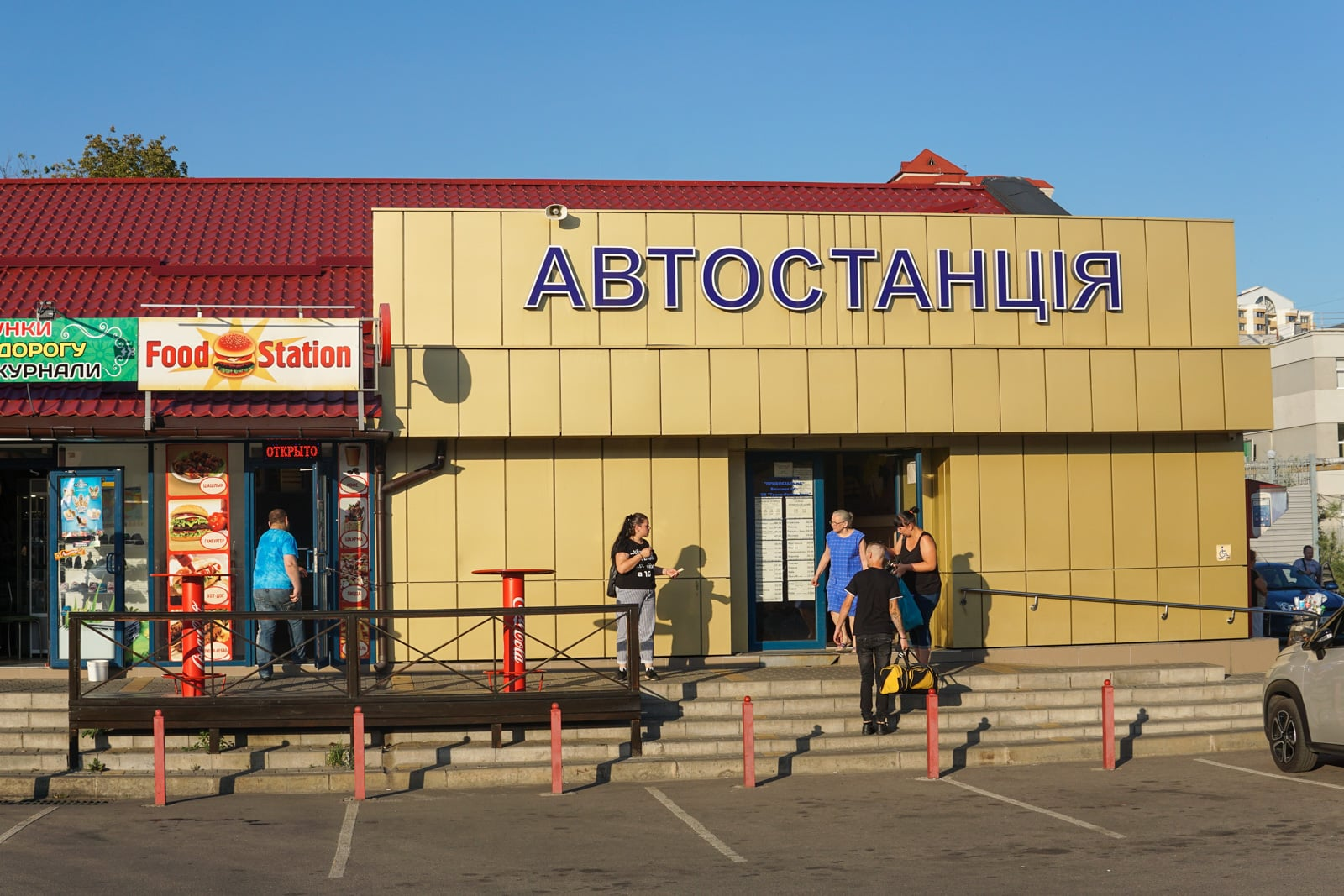 People standing outside the bus station in Belgorod, Russia