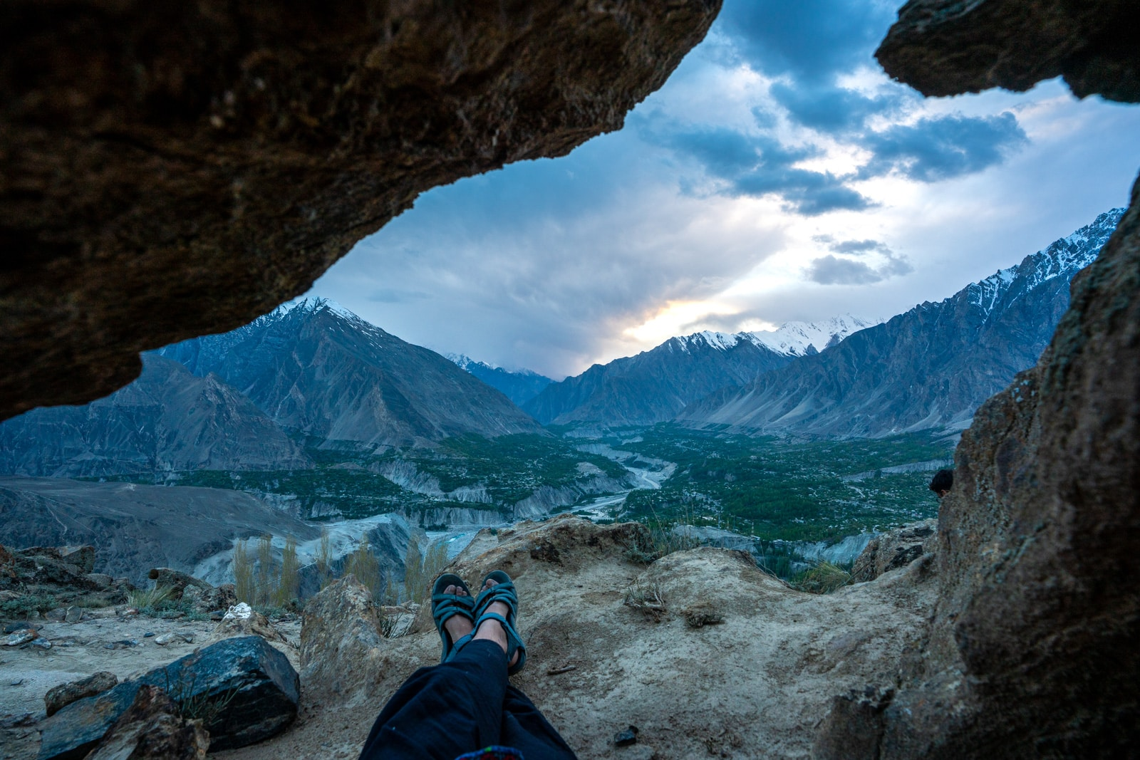 Feet and a view looking out over Hunza Valley, Pakistan