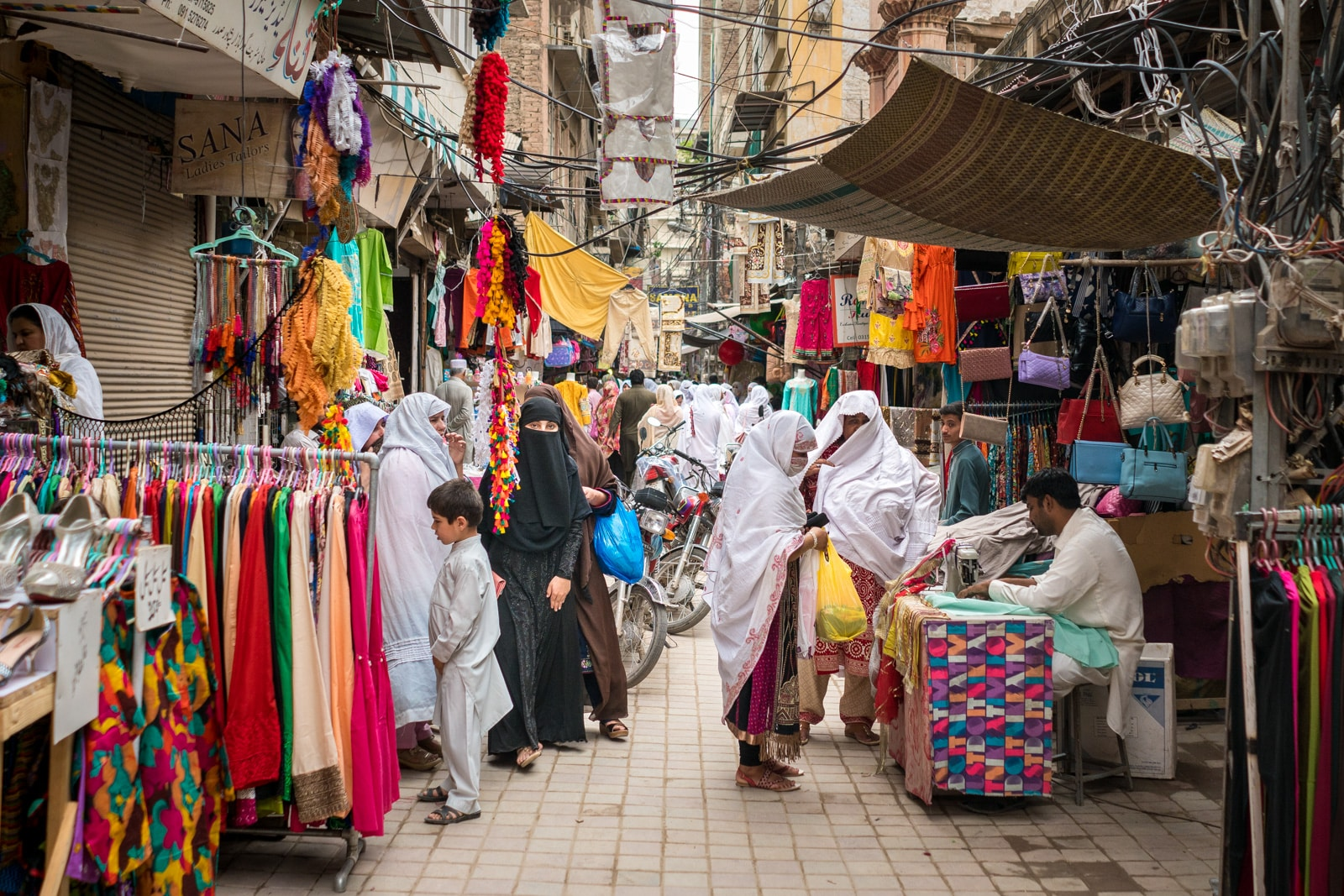 Ladies shopping for clothes in a bazaar in Peshawar, Pakistan