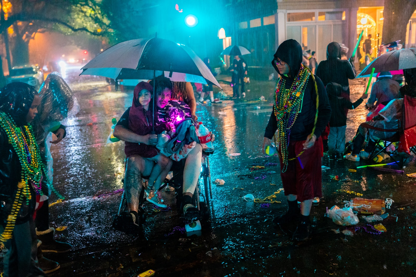 Family out in the rain at a Mardi Gras parade