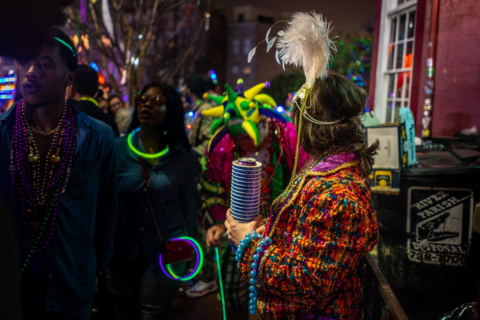 Woman in a jacket during Mardi Gras