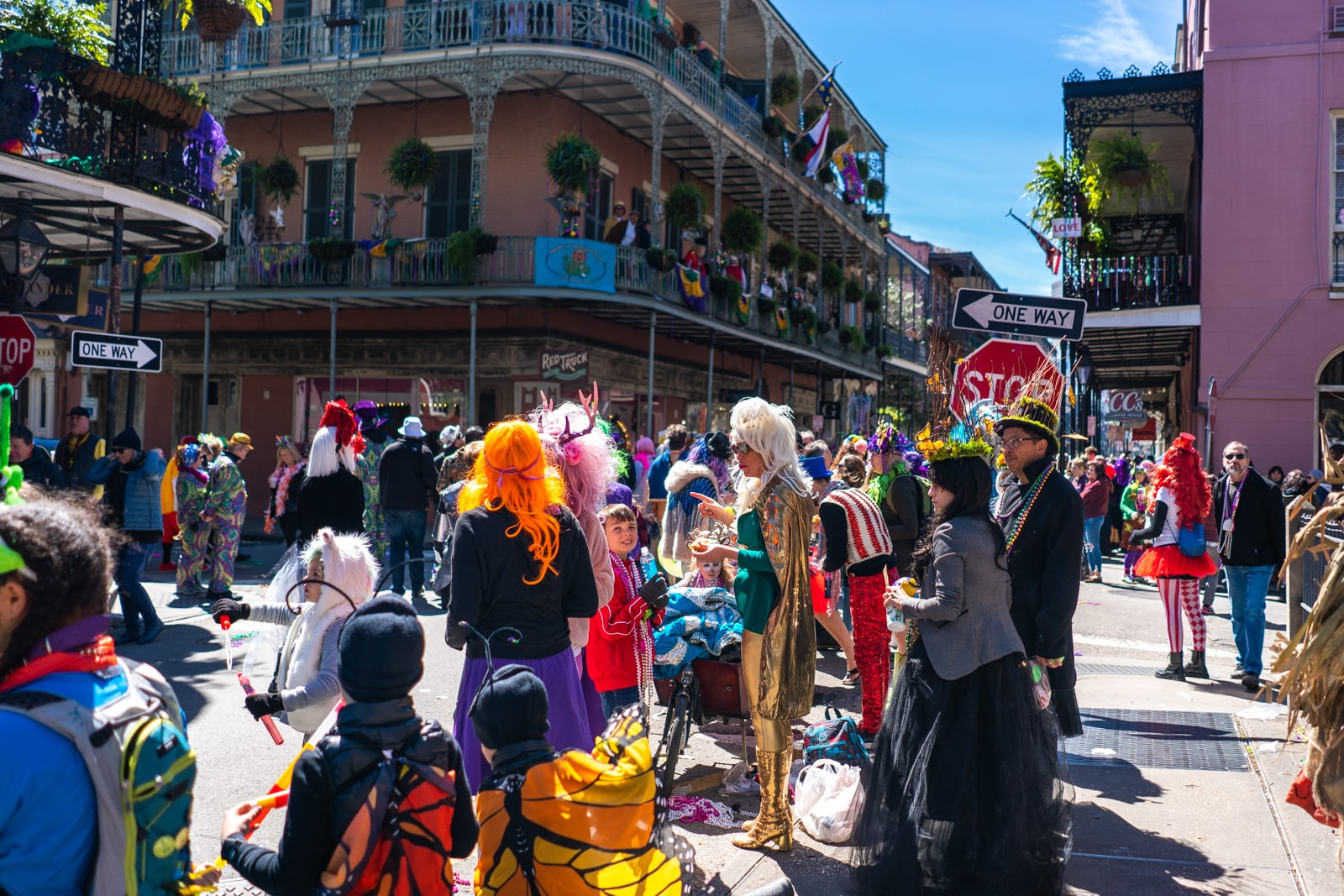 People partying in costume in the French Quarter during Mardi Gras in New Orleans