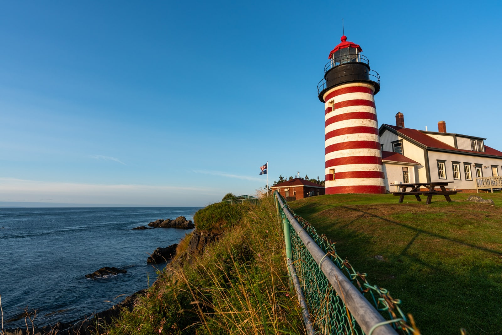Cliffside view of West Quoddy Head lighthouse in Lubec, Maine