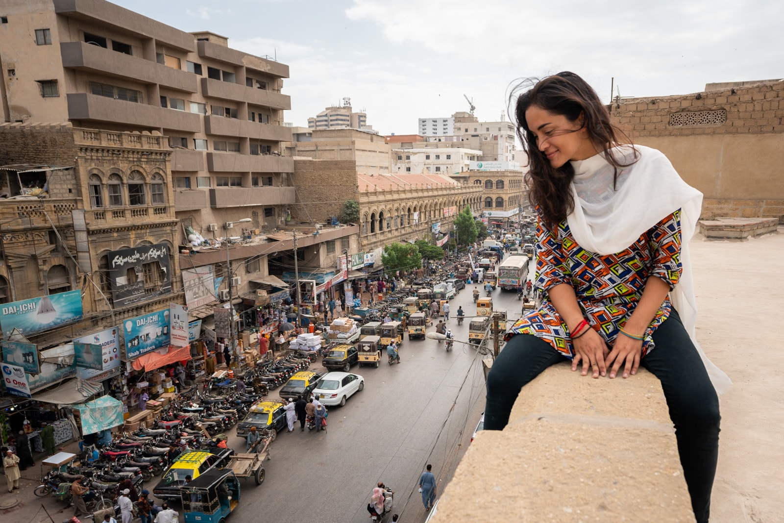 Female traveler overlooking streets of Karachi