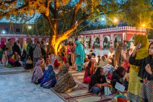 Women praying at the shrine of Mian Mir in Lahore, Pakistan