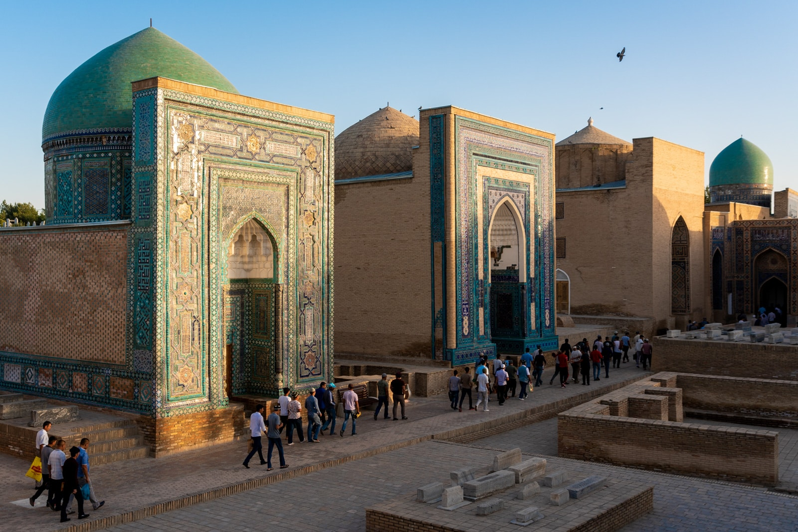 People walking through Shah-i-Zinda necropolis after praying