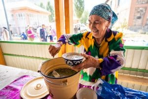 Woman serving soup in Khorog, Tajikistan