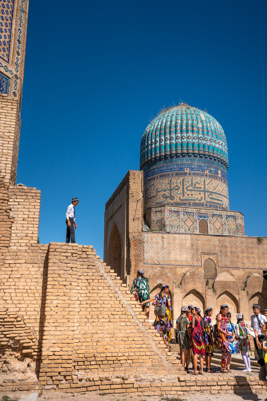 School children climbing on the Bibi Khanum mosque in Samarkand, Uzbekistan