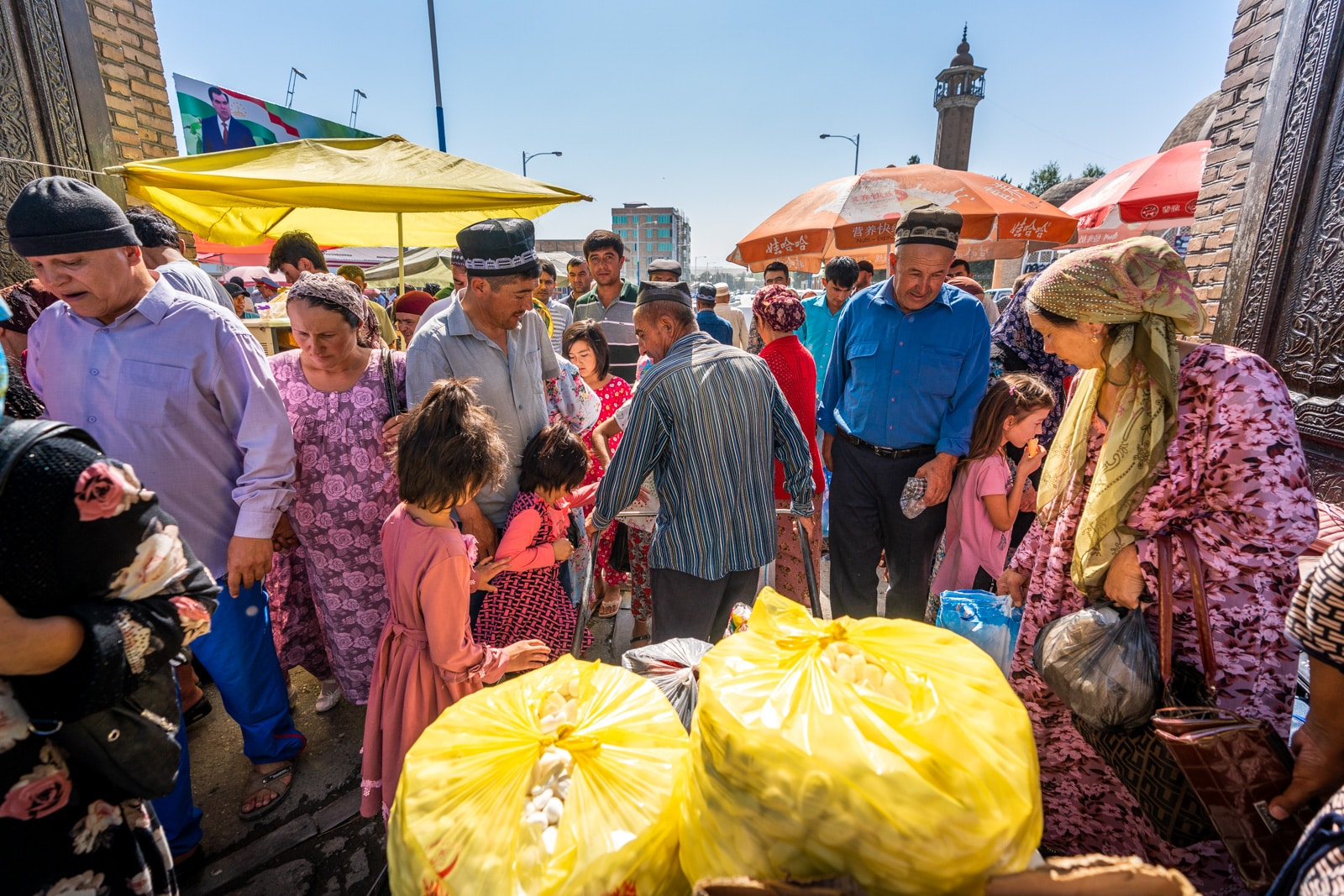 Man walking a cart through the Panjakent Bazaar in Western Tajikistan