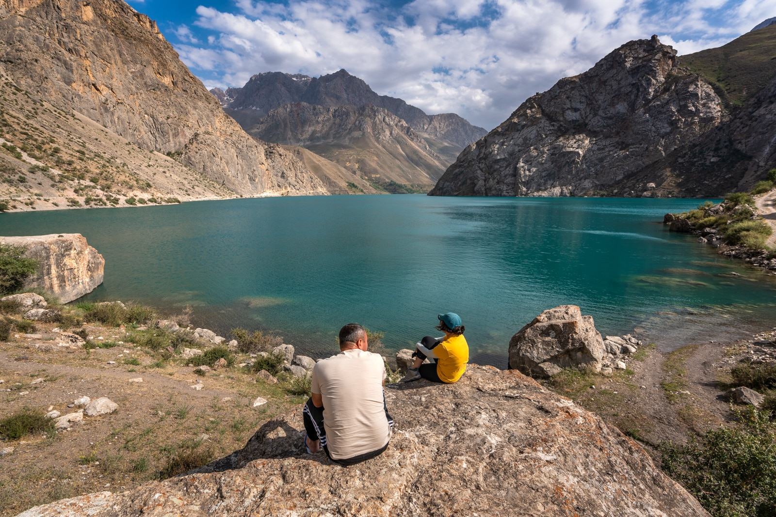 People sitting by one of the Haft Kol in Tajikistan