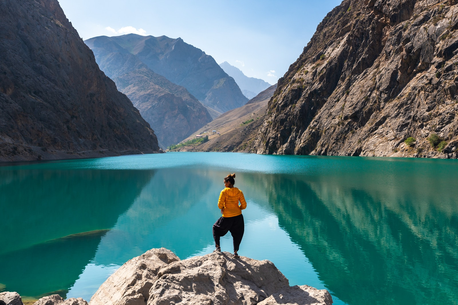 Girl standing in front of the fourth lake in Tajikistan's Haft Kol, Seven Lakes