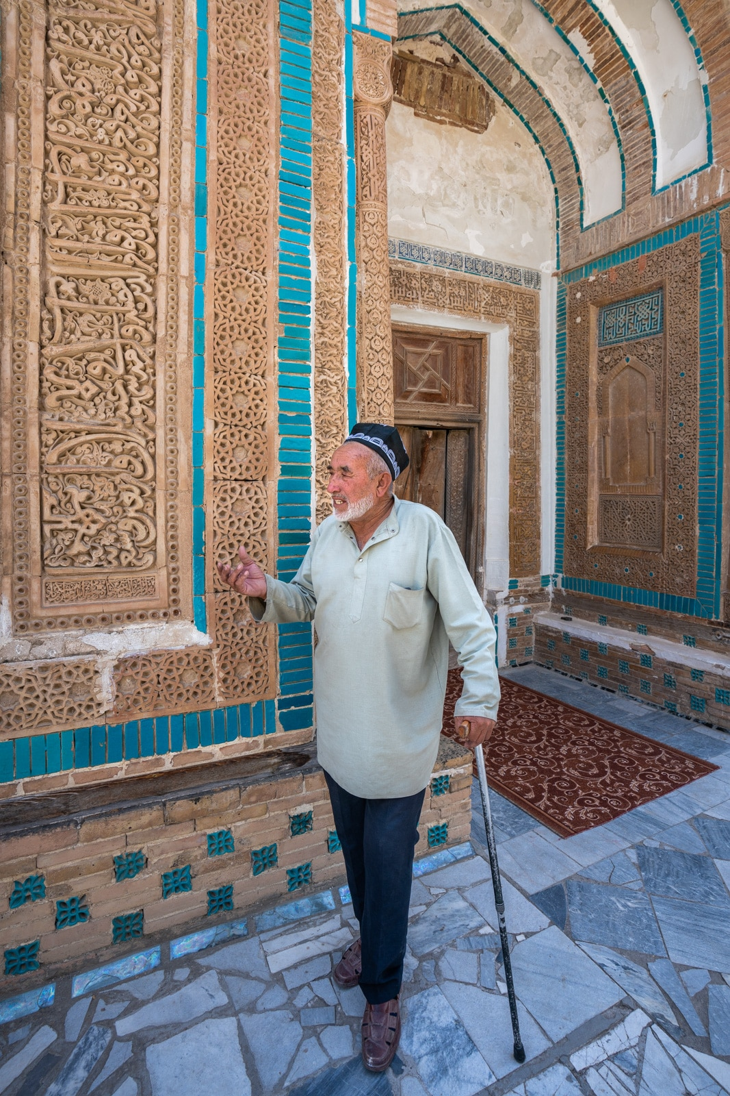 Man in front of mausoleum of Mohammad Bashoro in Mazor i Sharif, Tajikistan