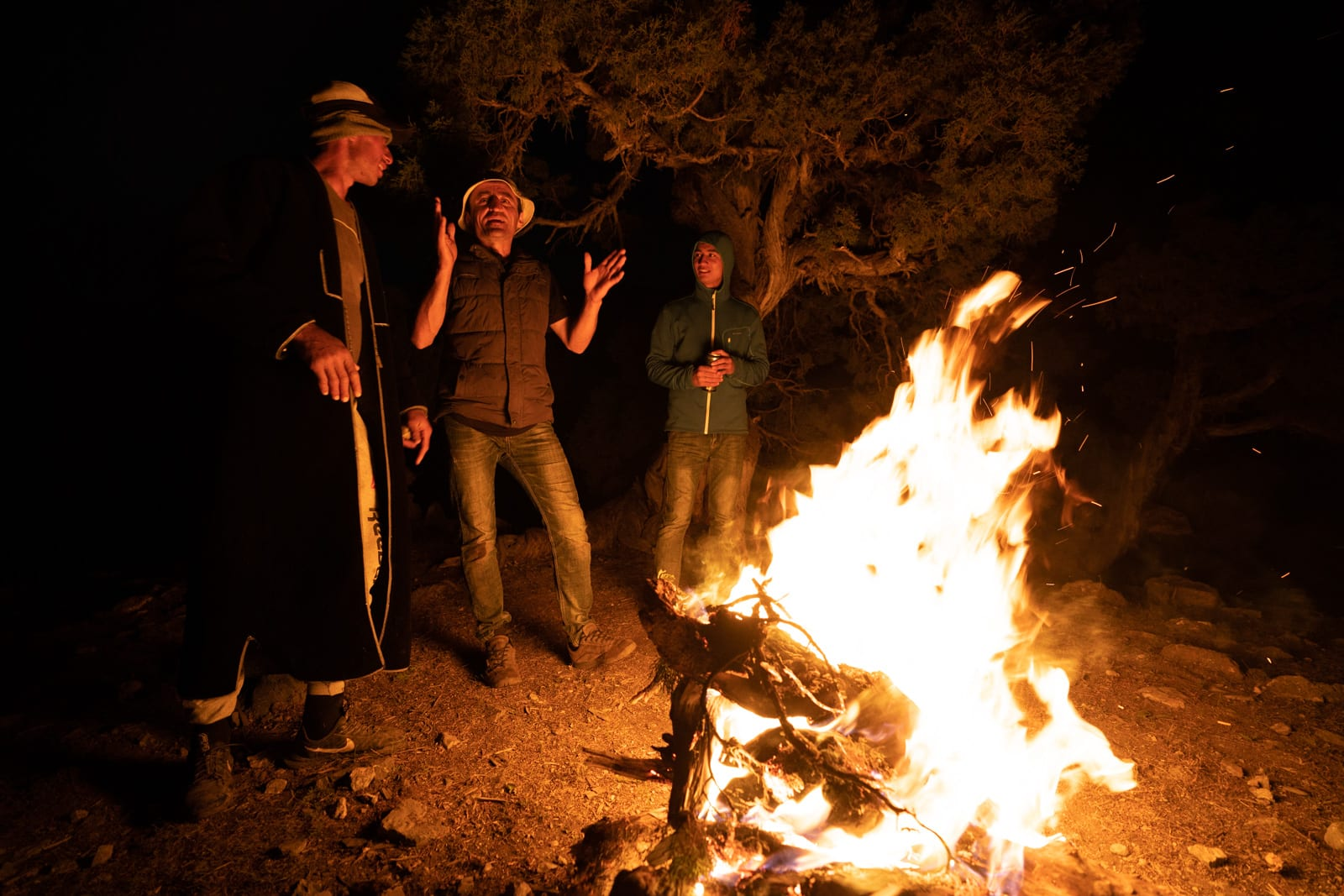 Men singing around a campfire in Western Tajikistan