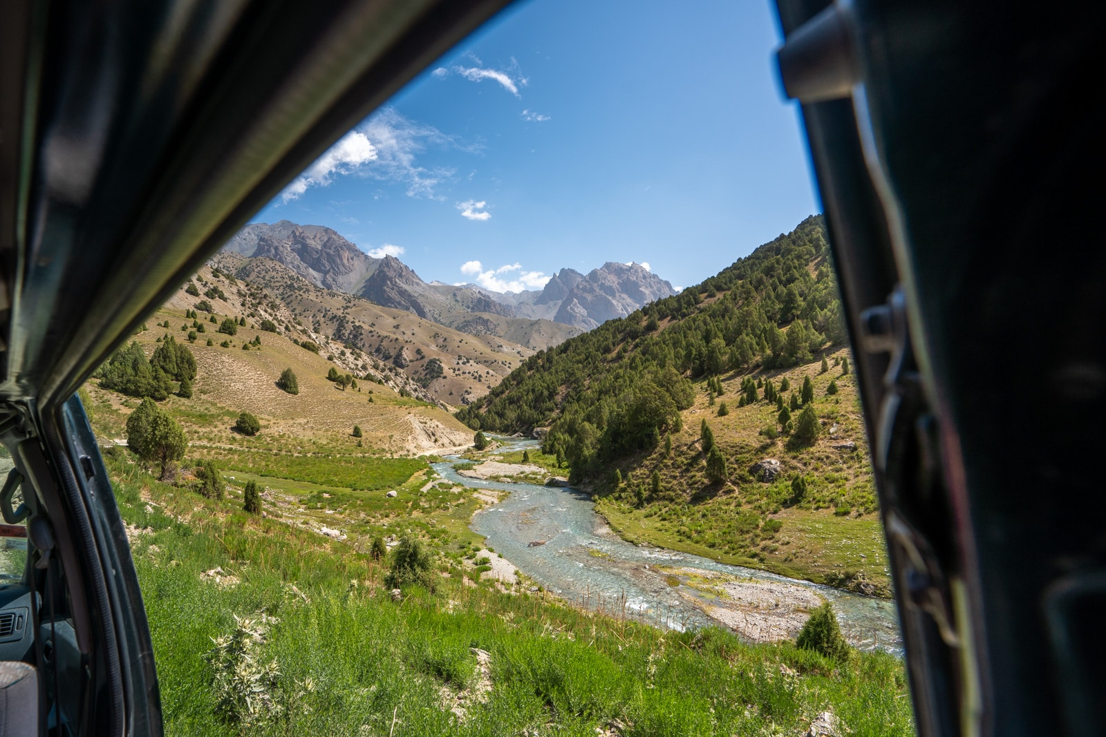 View of the Fann Mountains from inside a van