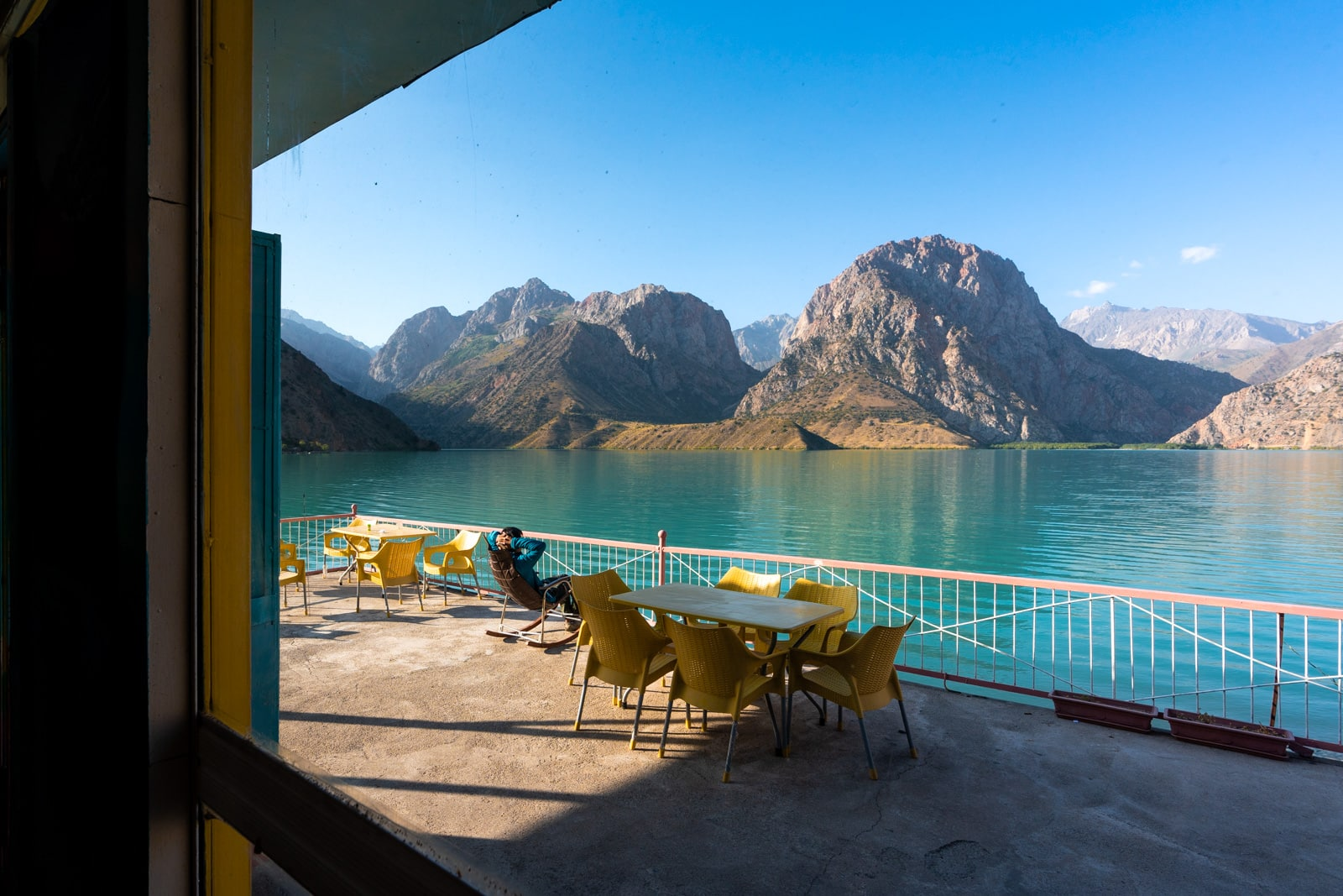 Person relaxing by Iskanderkul Lake in Tajikistan