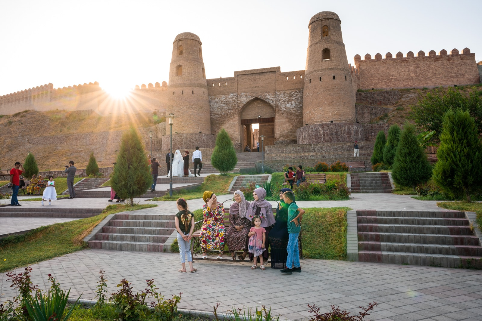 Women sitting outside Hissar Fort in Dushanbe, Tajikistan