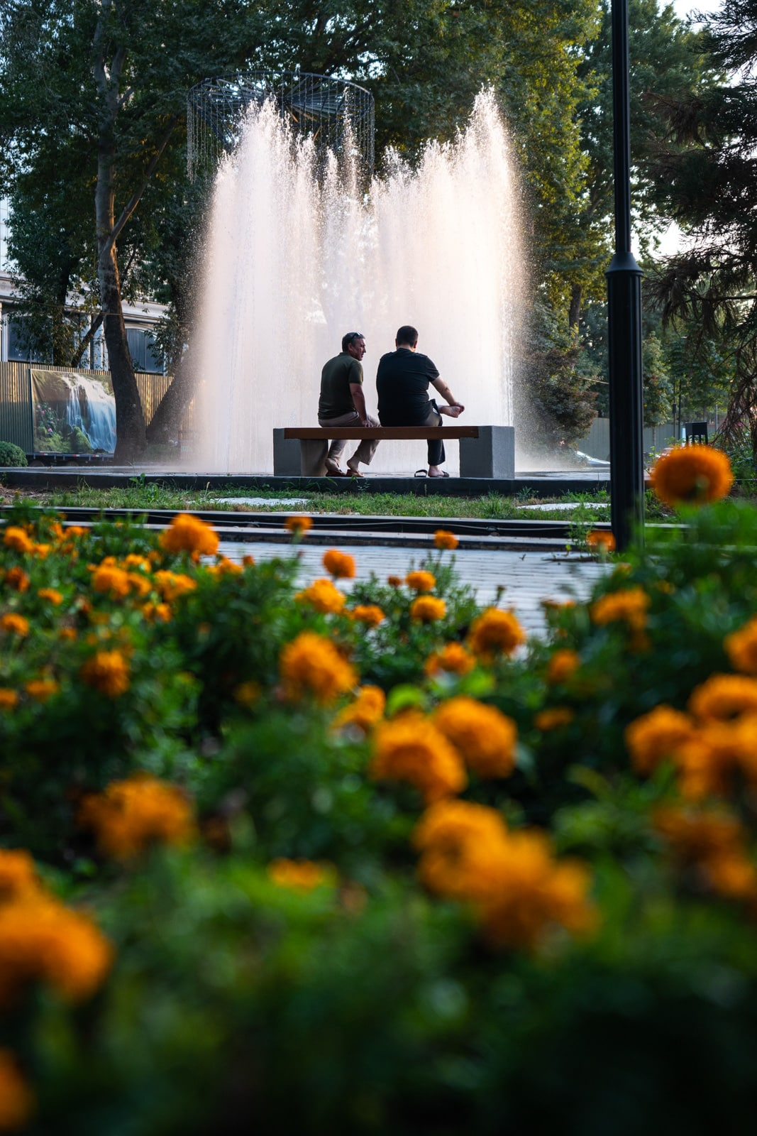 Men sitting by fountain in a park in Dushanbe, Tajikistan