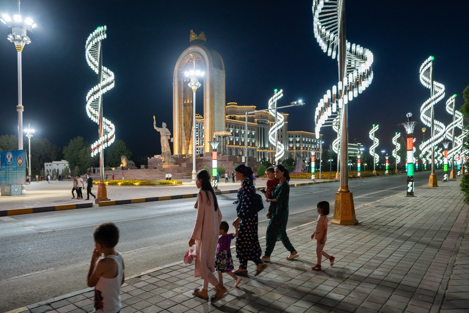 Women walking Dushanbe, Tajikistan's streets at night near the Somoni monument