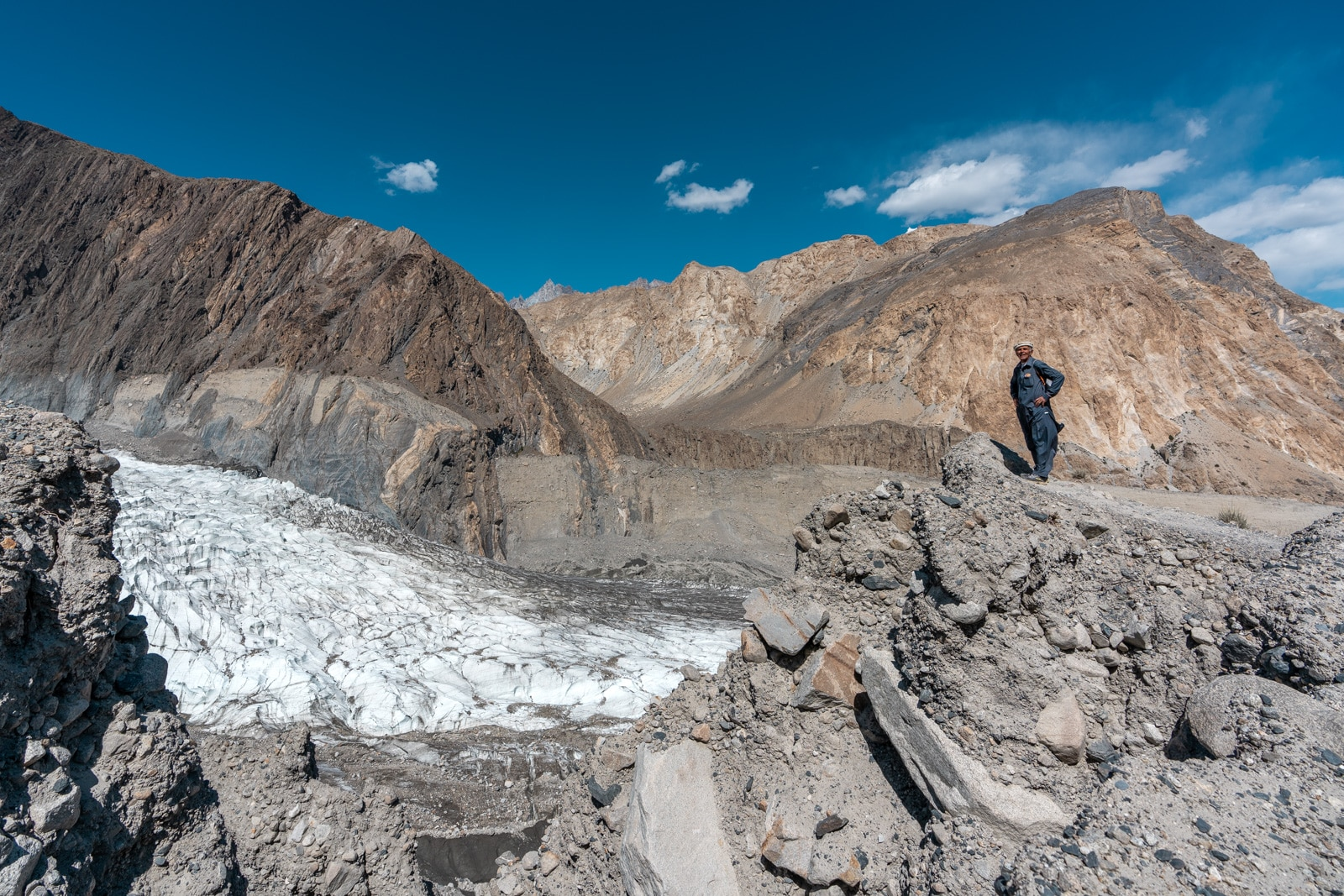 Local man standing by the White Passu Glacier in Gojal, Pakistan