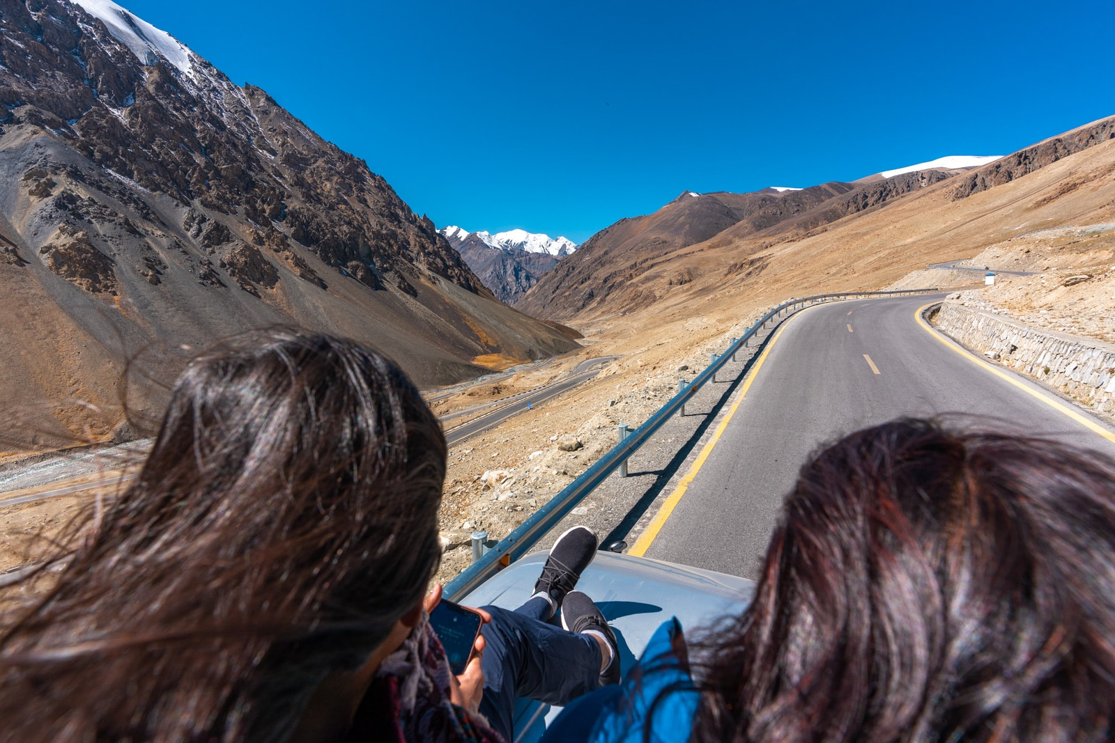 Girls sitting on top of a bus driving to Khunjerab Pass at the Pakistan-China border