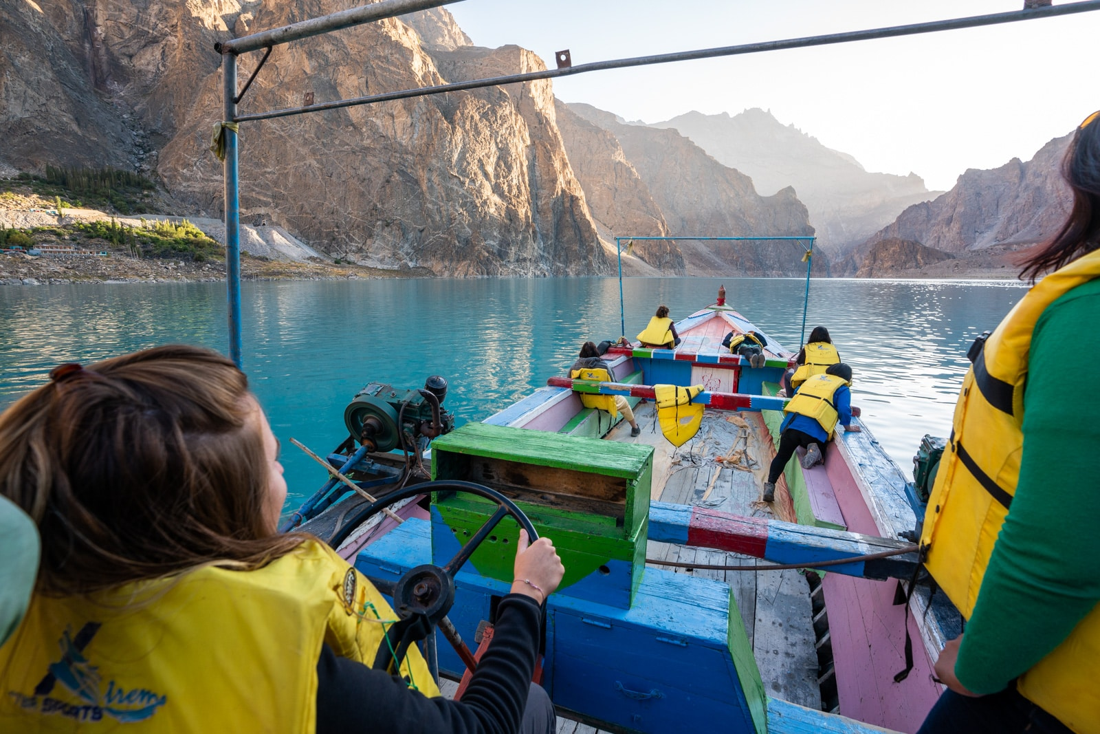 Female travel group boating across Attabad Lake, Gilgit Baltistan, Pakistan