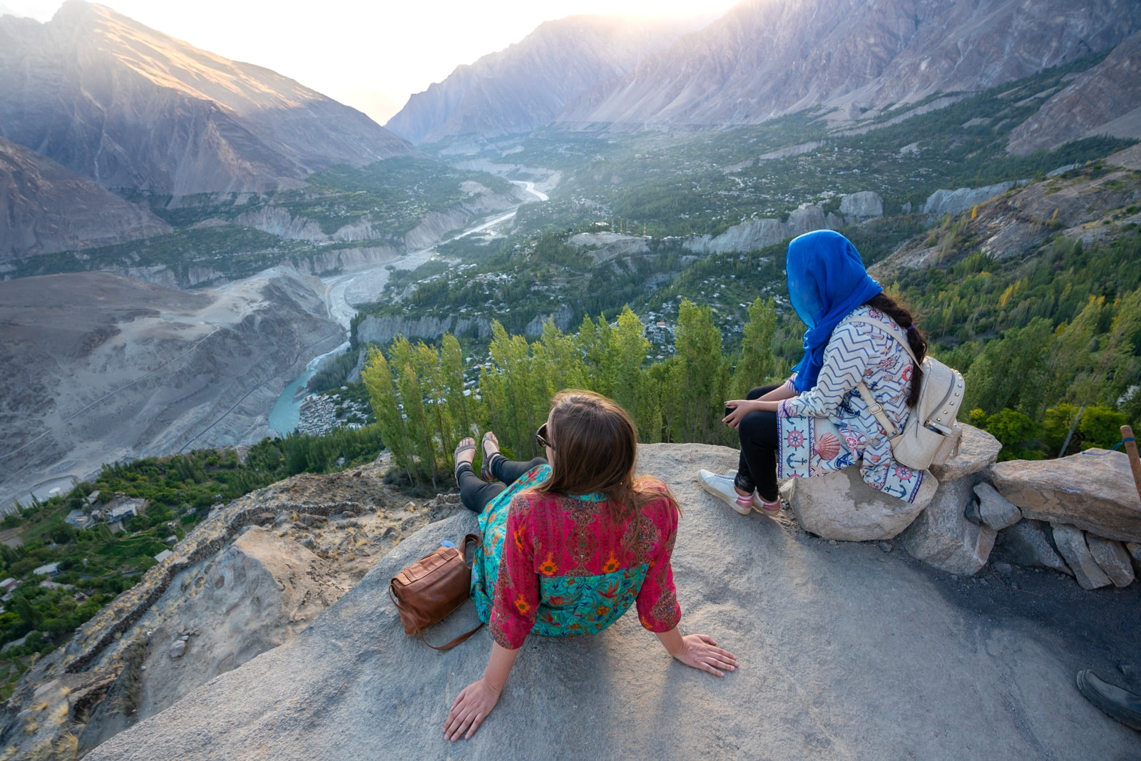 Women watching sunset at Eagle's Nest in Hunza on a women's tour of Pakistan