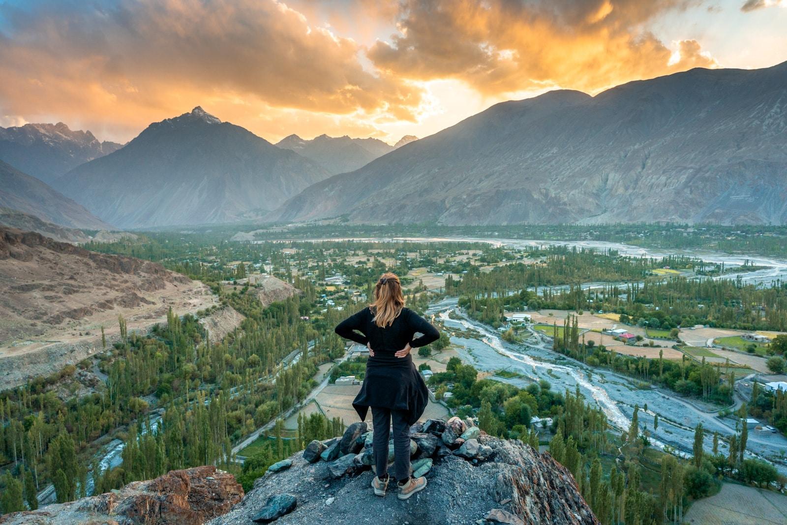 Female traveler watching sunset from Muduri Fort in Yasin Valley, Pakistan
