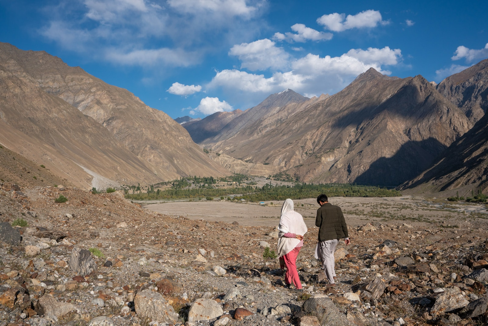 Couple walking in Darkot, Pakistan