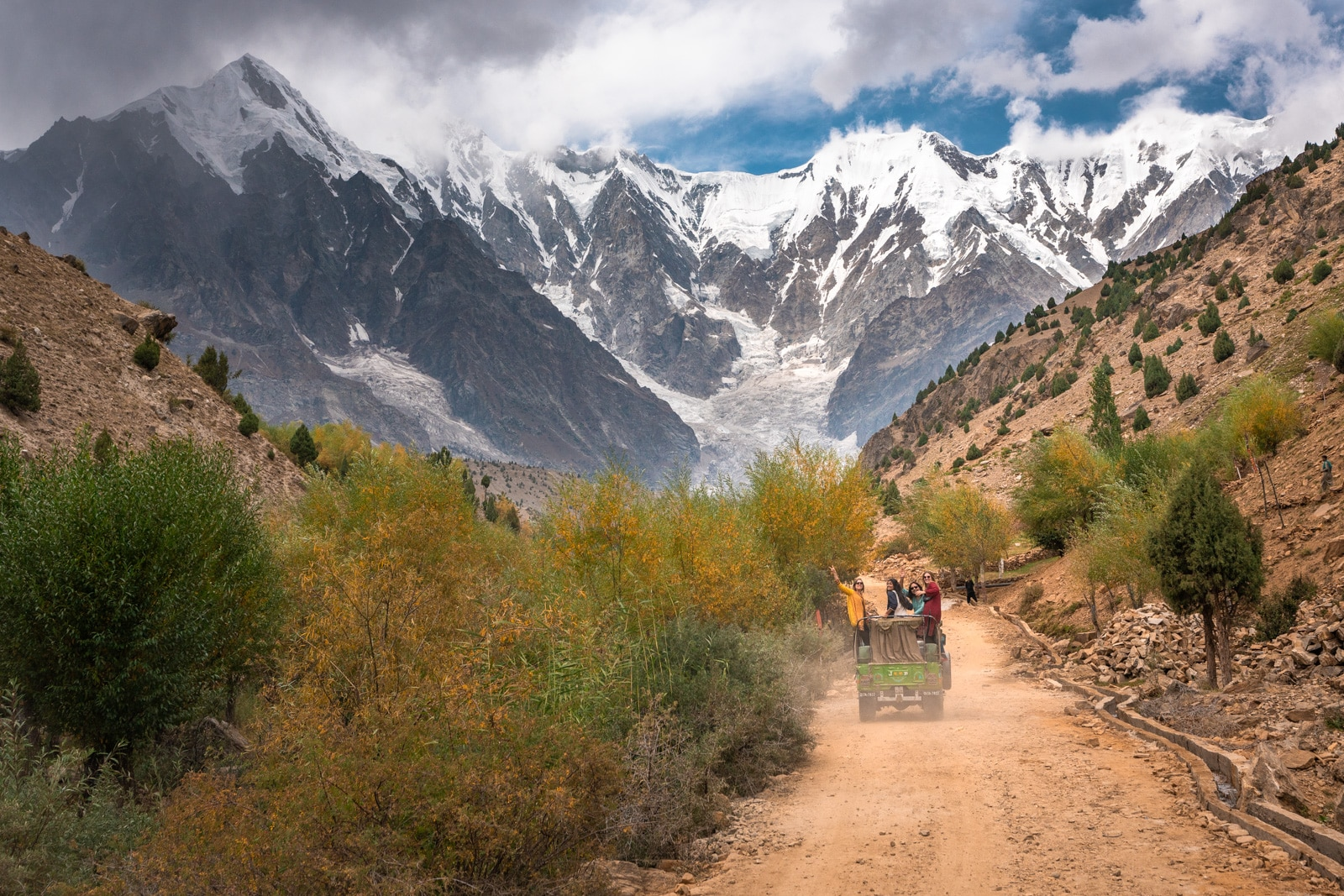 Girls riding in a jeep to Astore and Nanga Parbat on a women's tour of Pakistan