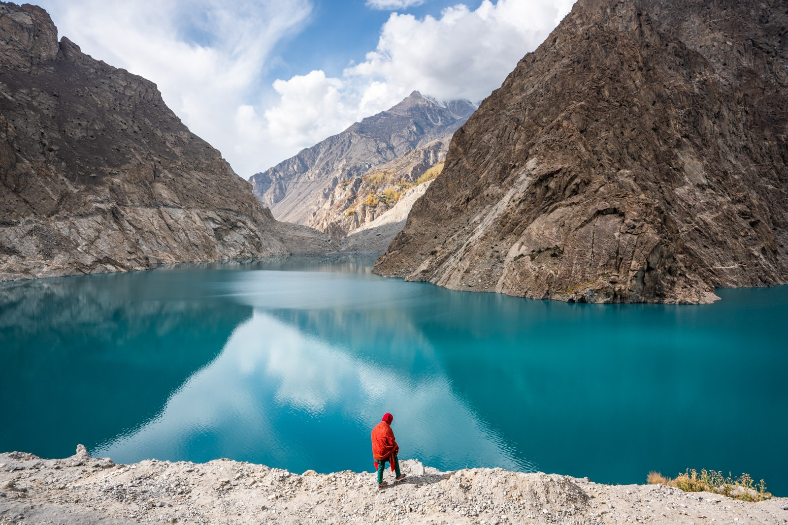 Woman standing by Attabad Lake in Gilgit Baltistan, Pakistan