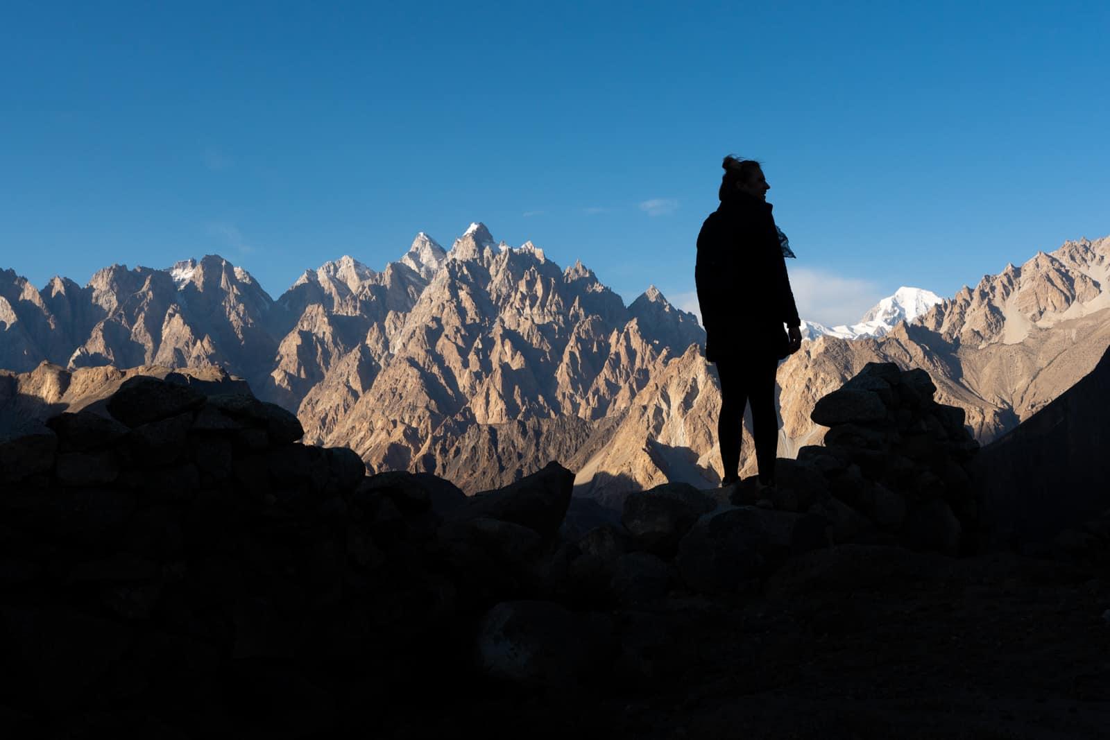 Girl standing in front of the Passu Cones in Hunza, Pakistan