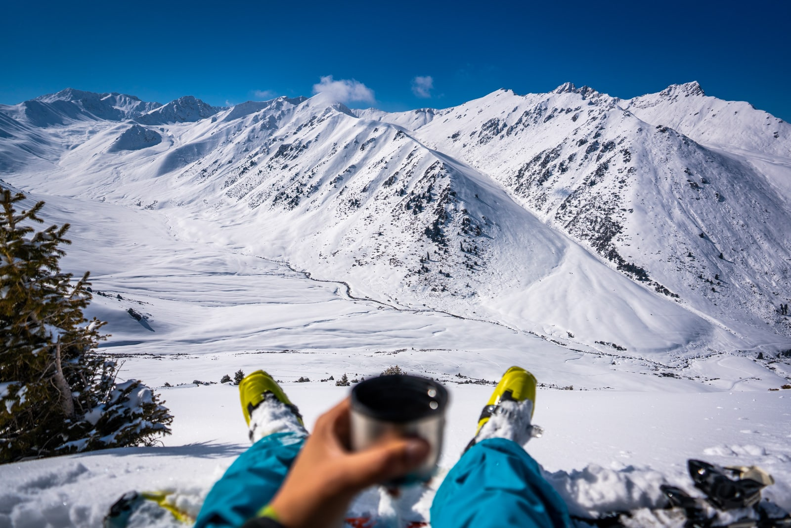 Skier overlooking mountains in Boz Uchuk, Kyrgyzstan in winter