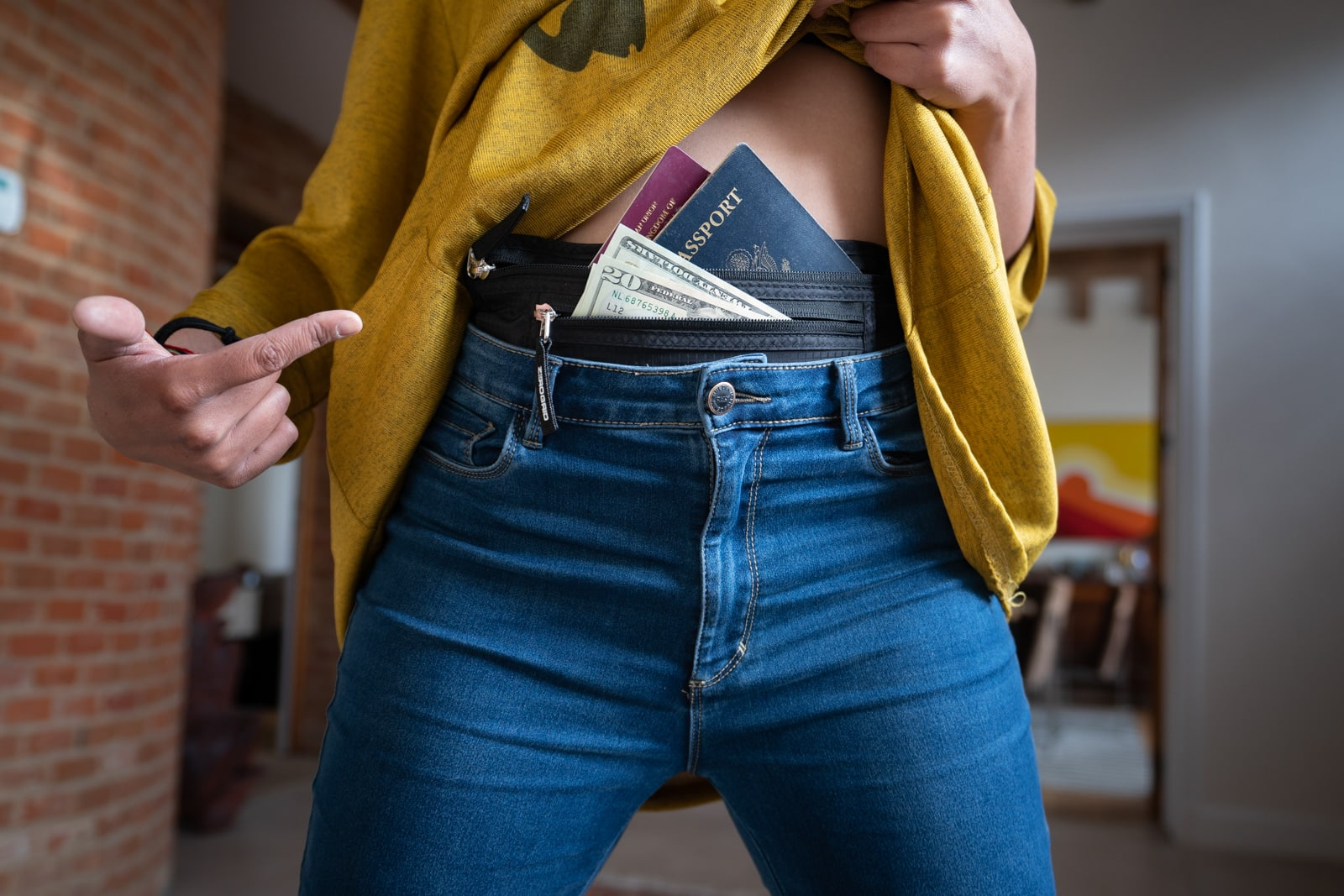 Backpacker with money belt and passports