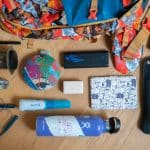 Flat lay of gifts for backpackers and long-term travelers