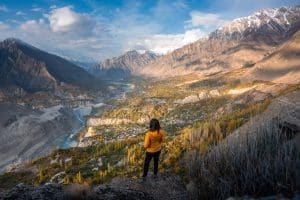 Solo female traveler in Pakistan overlooking Hunza valley from Eagle's Nest Viewpoint