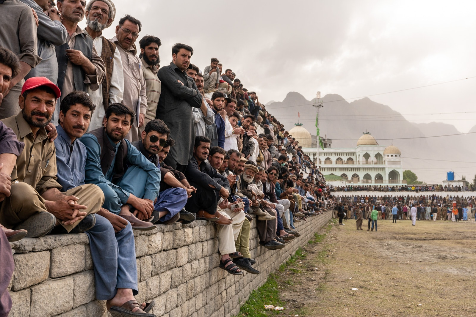 Men staring at a polo match in Gilgit, Pakistan