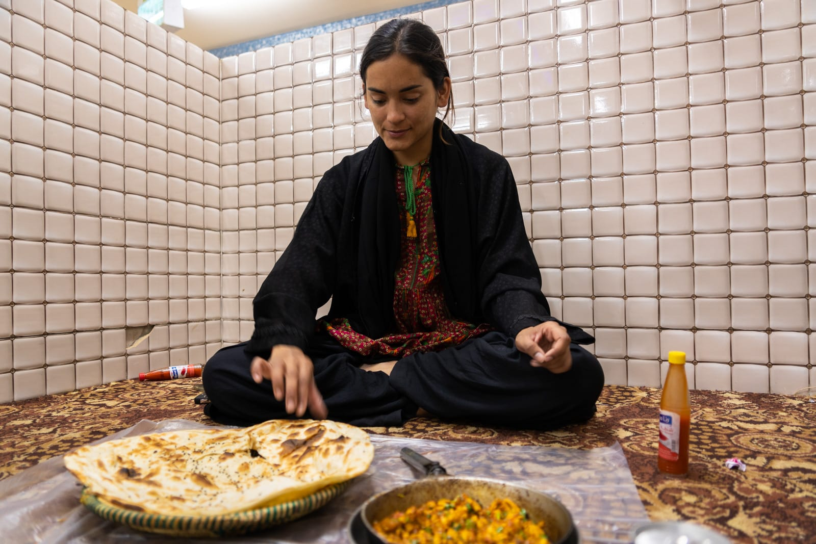 Female traveler eating in a family section of a Saudi Arabia restaurant