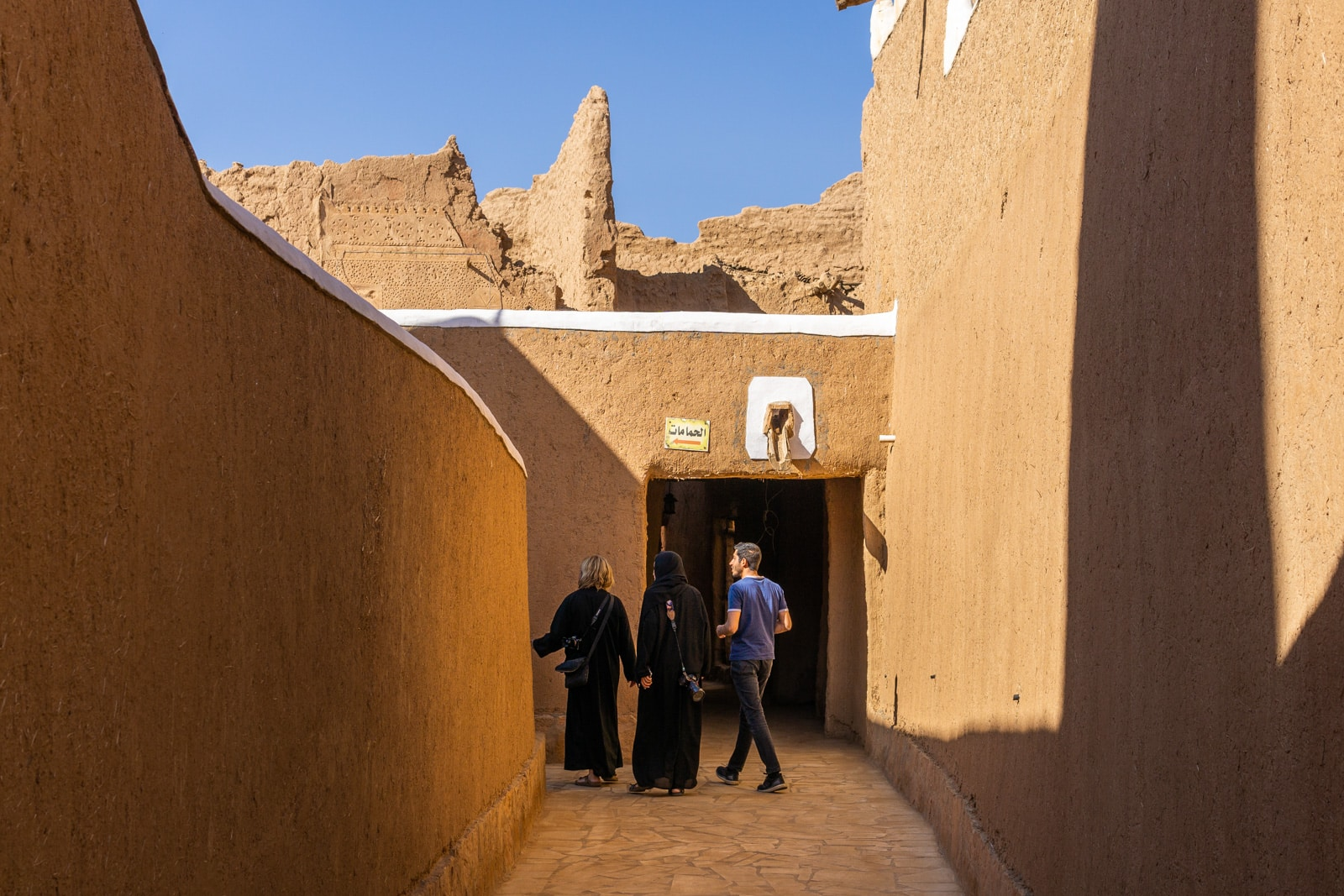 Women travelers in Saudi Arabia walking through Ushaiger with a male Couchsurfing host