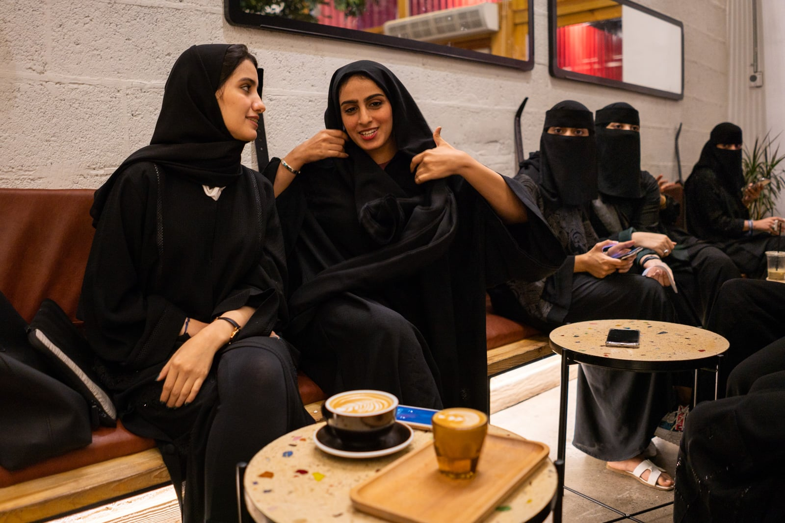 Young women in black sitting in the family section of a cafe in Jazan, Saudi Arabia