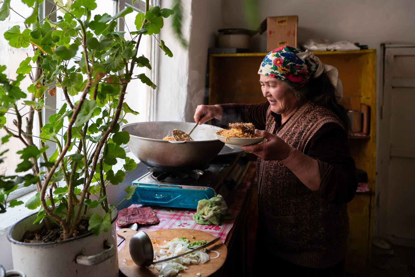 Woman cooking at a homestay in Shaimak village, Pamir, Tajikistan