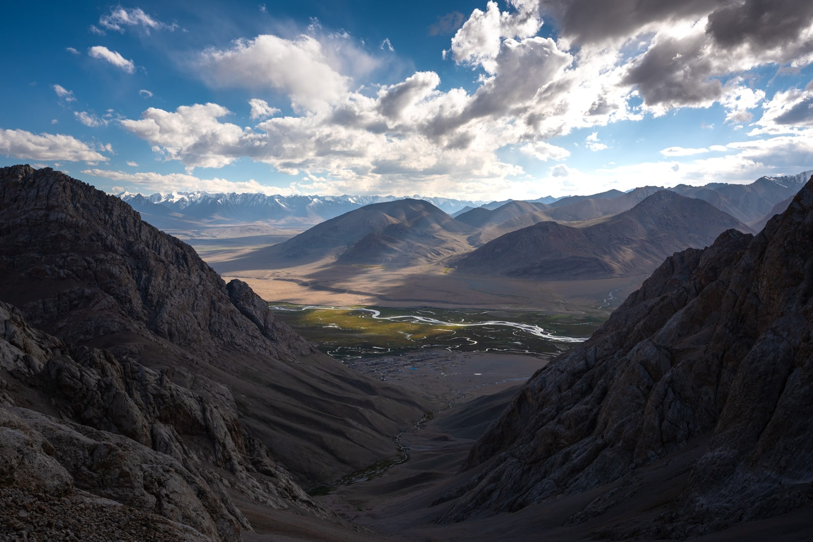 Sun rays over Shaimak Village in the Pamir mountains of Tajikistan