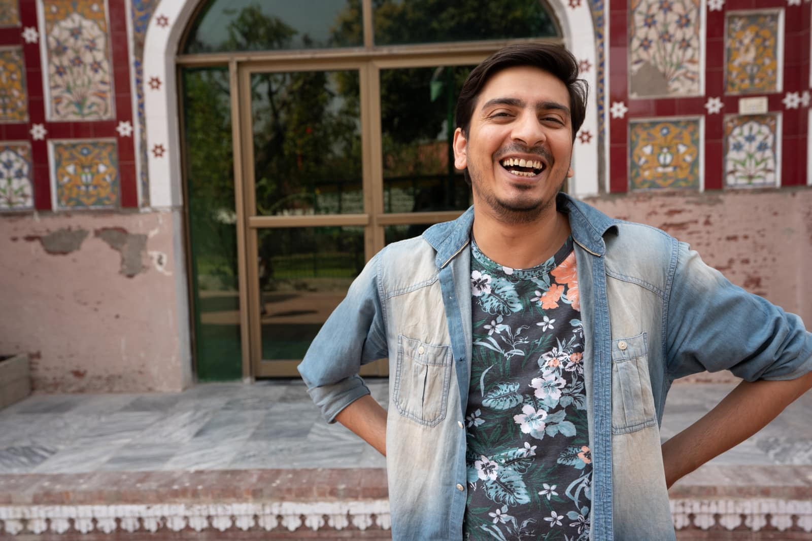 Man laughing at a mosque in Lahore