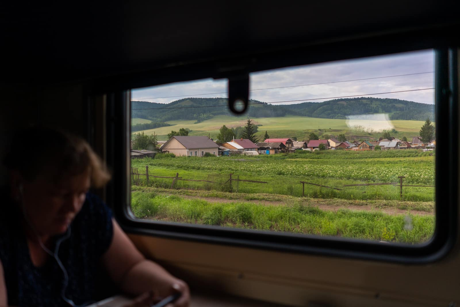 Siberian cottages and landscape from train window in Russia