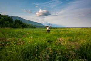 Solo female traveler walking in marshes in northern Lake Baikal, Siberia, Russia